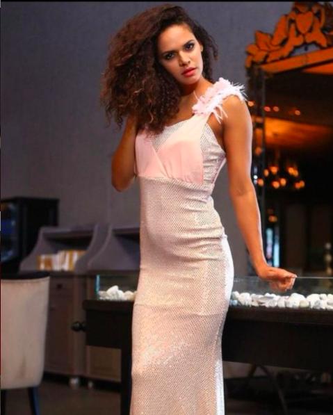 Model posing in a pink dress