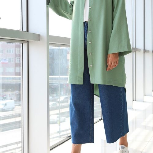 A look in style- A stylish green cardigan paired with wide legged cropped blue denim jeans